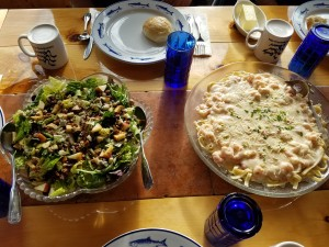 Salad, seafood pasta and homemade roll